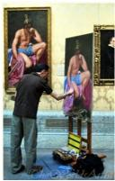 The worlds artist painting a reproduction copy in a museum