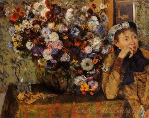 A Woman Seated Beside A Vase Of Flowers