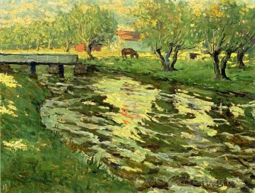 Horses Grazing By A Stream